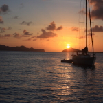 Sailing yacht Chao Lay at sunset in Grenada and the Grenadines.