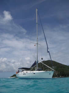 Sailing Yacht Chao Lay surrounded by azure blue water in Grenada