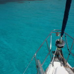 Picking up a mooring buoy under sail in the Tobago Cays.